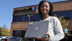 Sekeno Aldred displays her computer before donating it to Goodwill.