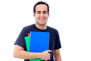 A male college student holding notebooks