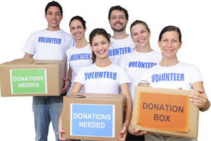 Group of volunteers hold donation boxes.