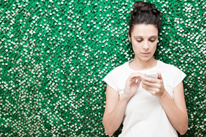 Young woman uses mobile app