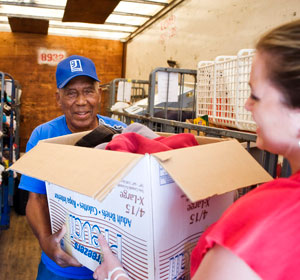 Woman donates box of items to Goodwill donation attendant