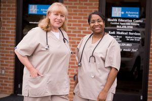 Two female nurses wearing tan scrubs