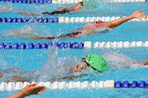 Backstroke swimmers in a close race