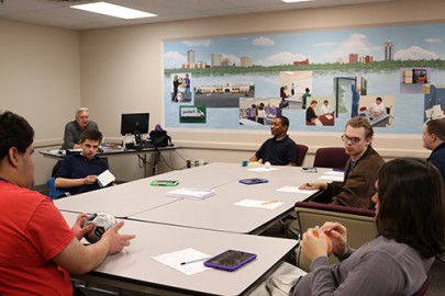 A students engage in a learning game during the specialized Autism class at Goodwill's Work Adjustment Training Program.