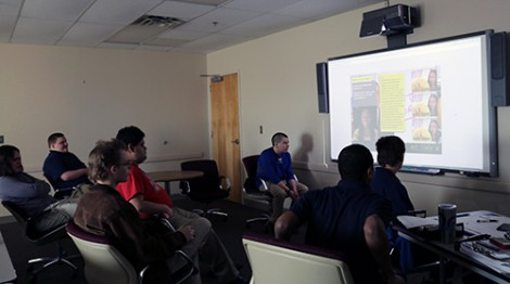 Students watch an instruction module during the specialized Autism class at Goodwill's Work Adjustment Training Program.