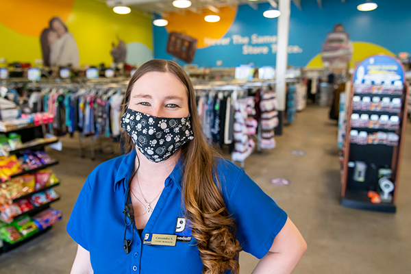 Woman wearing a mask in a store
